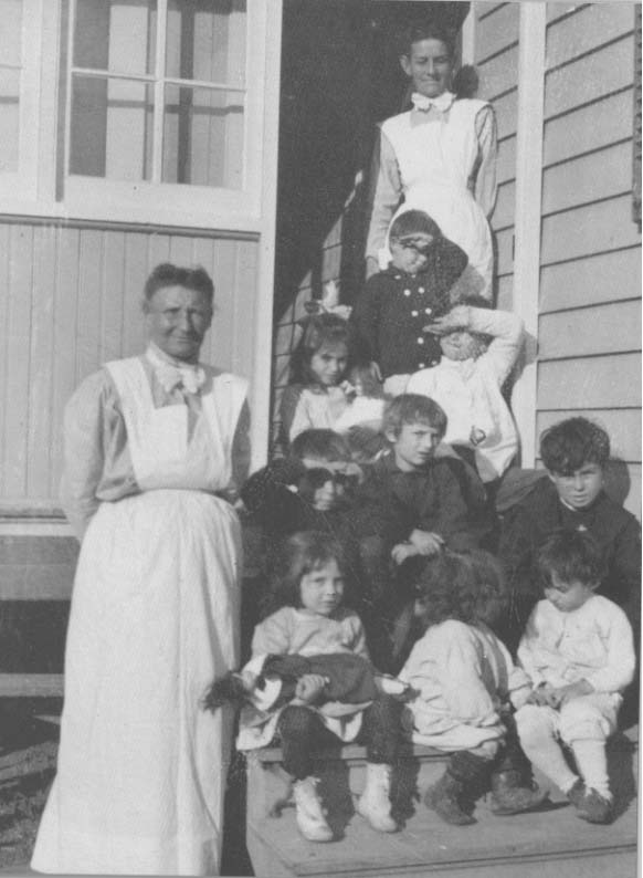 1907 teacher and kids.jpg